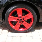 Rim with Black Center Cap and Red KIA Logo